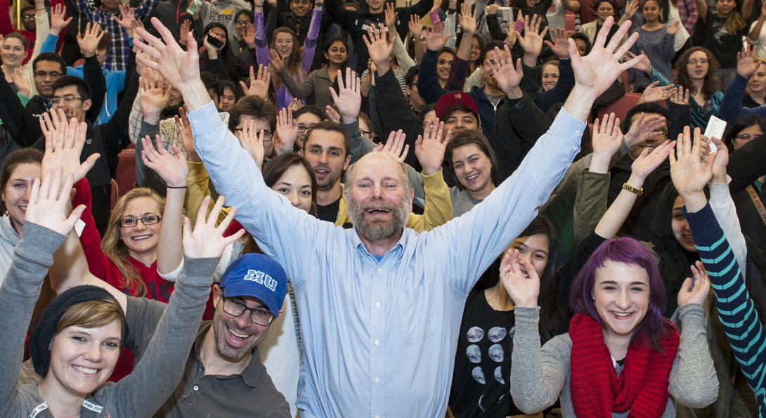 a group of people with their hands in the air