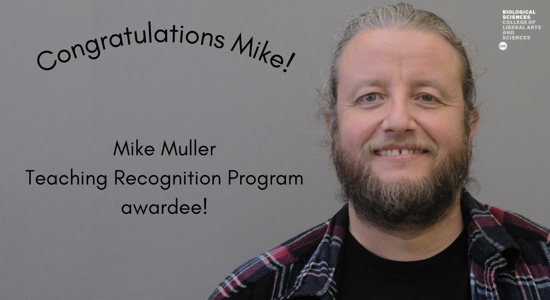 a man with a beard in a plaid shirt next to award info